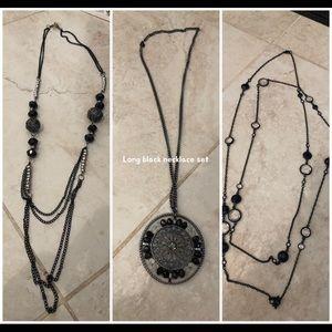 Three long black necklaces